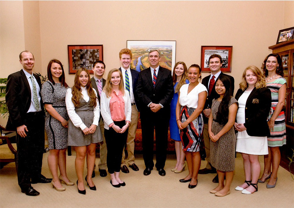 Jordan and Senator Jeff Merkley group photo